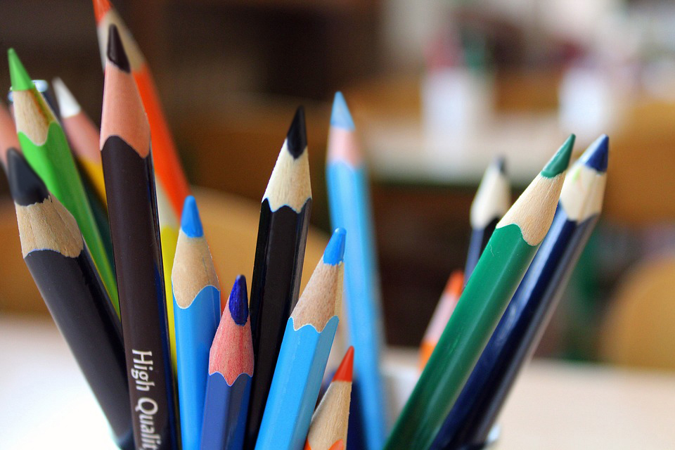 Header image for About page, featuring brightly colored pencils.